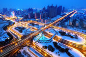 He modern city viaduct night Snow — 图库照片