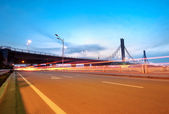 Bridges and light trails — Stock Photo