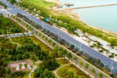 A bird's eye view of the road near the city — Стоковое фото