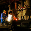 And workers in metal casting processes - Stock Photo