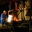And workers in metal casting processes — Stock Photo