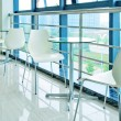 Tables and chairs on the corridor — Foto Stock