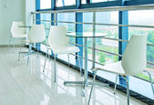 Tables and chairs on the corridor — Stock Photo