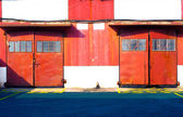 Red door warehouse — Stock Photo