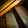 Golden escalator — Stock Photo