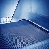 Golden escalator — Stock Photo