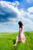 Woman walking on the prairie — Stock Photo