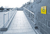 Using wheelchair ramp — Fotografia Stock