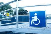 Using wheelchair ramp — 图库照片
