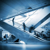 At the airport escalator — Stock fotografie