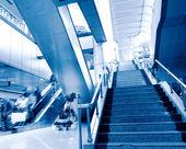 At the airport escalator — Stock Photo