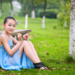 Girl sitting on the grass — Stock Photo