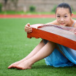 Stock Photo: Girl sitting on grass