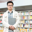 Handsome man in the library — Stock Photo