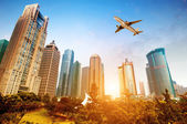 Skyscrapers and airplanes — Stock Photo