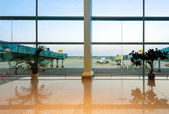 Airports with large windows and aircraft — Stok fotoğraf