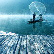 Lake and fishing people — Stock Photo