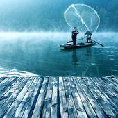 Lake and fishing people — Stock Photo