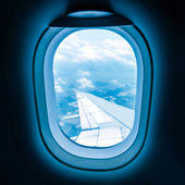 Airplane porthole — Stock Photo