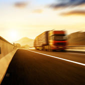 Red truck traveling at high speed — Stok fotoğraf