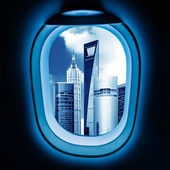 Outside the window of the plane cityscape — Stock Photo