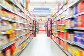 Empty supermarket aisle — Stock Photo