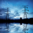 The high-voltage tower at night — Stock Photo
