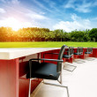 Foto Stock: Outdoor tables and chairs meetings
