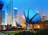 Shanghai's skyscrapers and satellite antenna — Stock Photo
