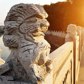 Stone lions on the bridge — Stock Photo