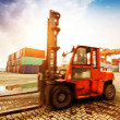 Forklift handling the container box at dockyard with beautiful s — Stock Photo