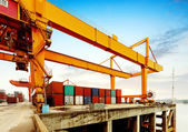 Cranes and container terminal on — Stock Photo