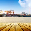 Container stacks and ship under crane bridge — Stock Photo #47879203