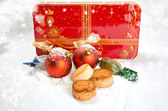 Christmas balls with sweet and gift box — Stock Photo