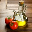 Stock Photo: Tomatoes and extrvirgen olive oil