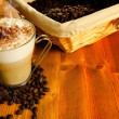 Foto Stock: Cappuccino with coffee beans