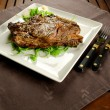 Grilled beef steak with bone — Stock Photo #17417133