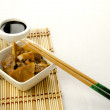 Chinese food, beef with bamboo and mushrooms - Stock Photo