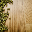 Soybeans on wooden background — Stock Photo