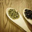 Stock Photo: Soybeans and black beans in wooden spoons