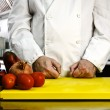 Chef hands cutting vegetables — Stock Photo