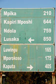Road sign, direction to different places (Zambia) — Stock Photo