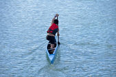 Young athlete in a canoe — Stock Photo