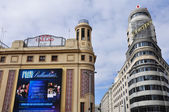 Callao cinema and Carrion Building (also known as Capitol Building) on February 3, 2013 in Madrid, Spain. It was built in 1931 and it is one of the best known of the Gran Via. — Stock Photo