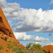 Uluru (Ayers Rock) is a large sandstone rock formation in the Northern Territory, Australia. This rock is sacred to the Aboriginal people. - Stock Photo