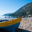 Fishing boat at Cirali beach, Turkish Riviera — Stock Photo #26517213