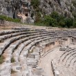 Ancient amphitheater and Lycian tombs in Myra (Turkey) — Stock Photo