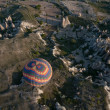 Hot air balloon flies over Cappadocia on April 30, 2013 in Cappadocia, Turkey — Stock Photo