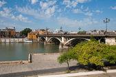 Isabel II bridge (Triana Bridge), Guadalquivir river in Seville — Stock Photo