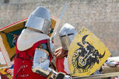 Fighters on the World Championship of Medieval Combat on May 2, 2014 in Belmonte, Cuenca, Spain. This championship is celebrating in the Belmonte castle from May 1 to May 4. — Stock Photo